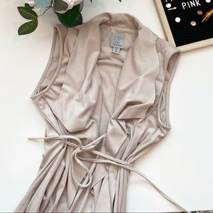 Suede sleeveless vest with front cascading ruffles